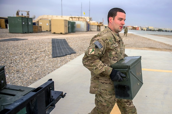 U.S. Air Force Senior Airman Austin Stoker, a munitions systems specialist deployed to the 26th Expeditionary Rescue Squadron, replenishes a .50-caliber machine gun after a training mission over an undisclosed location in Afghanistan, March 11, 2013.