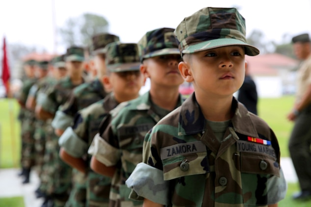 Eagle Young Marines form up in a column in preparation for their graduation ceremony held at the base theater here August 10. The Eagle Young Marines of the Marine Corps League is a non-profit youth organization dedicated to drug demand reduction, academics, and community service.