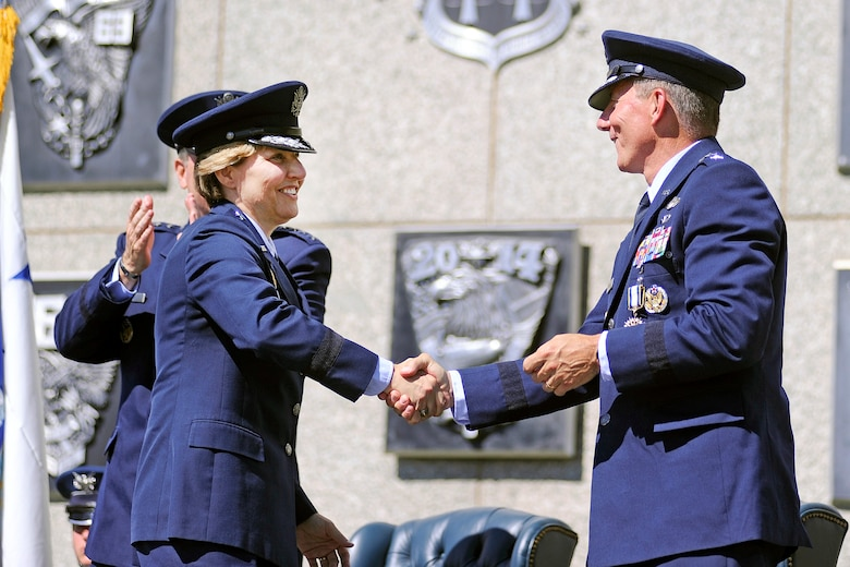 Lt. Gen. Michelle Johnson (left) shakes hands with Lt. Gen. Mike Gould after being recognized as the superintendent of the Air Force Academy during the change of command cermony Aug. 12, 2013. (U.S. Air Force photo/Sarah Chambers)