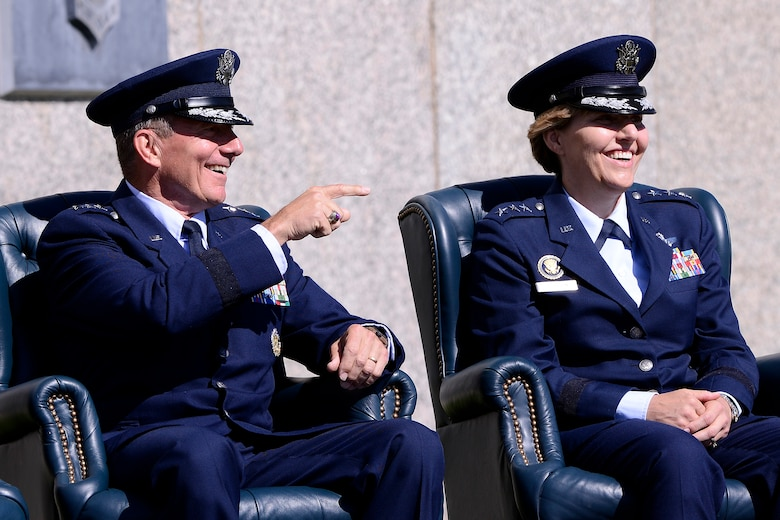 Lt. Gen. Michelle Johnson (right) and Lt. Gen. Mike Gould share a laugh during a speech at the Academy Superintendent Change of Command cermony Aug. 12, 2013. Johnson takes over for Gould as the Academy's newest superintendent. (U.S. Air Force photo/Mike Kaplan)