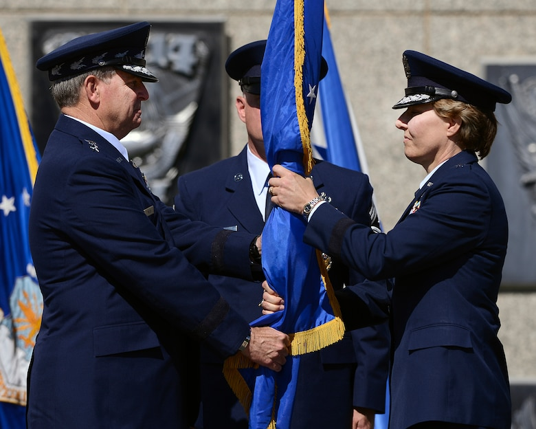 Lt. Gen. Michelle Johnson (right) accepts the guidon from Gen. Mark Welsh during the Academy Superintendent Change of Command cermony Aug. 12, 2013. Johnson is the Academy's 19th superintendent. (U.S. Air Force photo/Mike Kaplan)