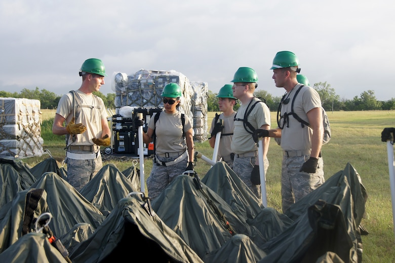 Members of the 35th Combat Communications Squadron, Tinker Air Force Base, Okla., hone their skill during a field training exercise at the Lackland AFB Media Annex in San Antonio, Texas. The 35th CBCS is one of four Reserve combat communications squadrons each located in separate regions of the country that provide theater-deployable communications during wartime and contingency operations or humanitarian missions in austere locations.