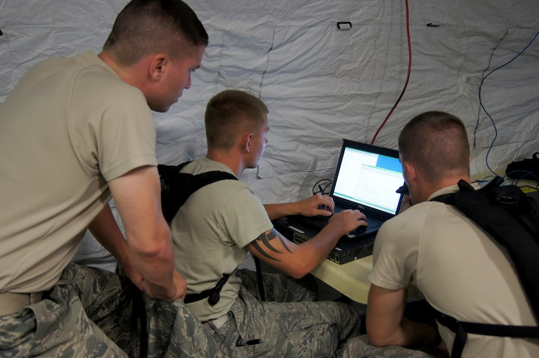 Members of the 35th Combat Communications Squadron, Tinker Air Force Base, Okla., hone their skill during a field training exercise at the Lackland AFB Media Annex in San Antonio, Texas. The 35th CBCS is one of four Reserve combat communications squadrons located in separate regions of the country that provide theater-deployable communications during wartime and contingency operations or humanitarian missions in austere locations.