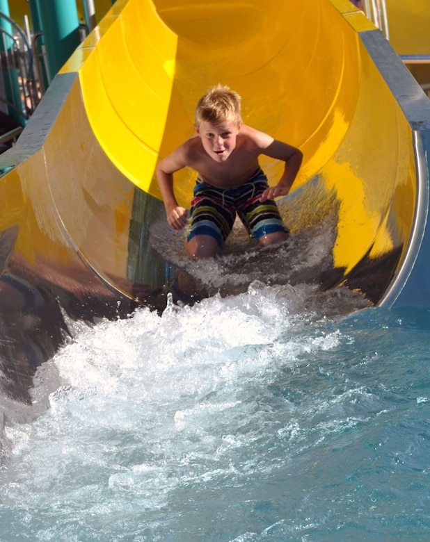A child rides a six meter long water slide at the Schweich swimming and entertainment pool complex.  The Eifel region has more than 20 public pools, numerous lakes and outdoor swimming pools. Most public pools are open now for the summer and will close again at the end of September.  Opening times and entry prices vary for each pool, but most of them typically run between 2-4 Euro for adults and 1.50-2.50 Euro for children. (U.S. Air Force photo by Iris Reiff/Released)