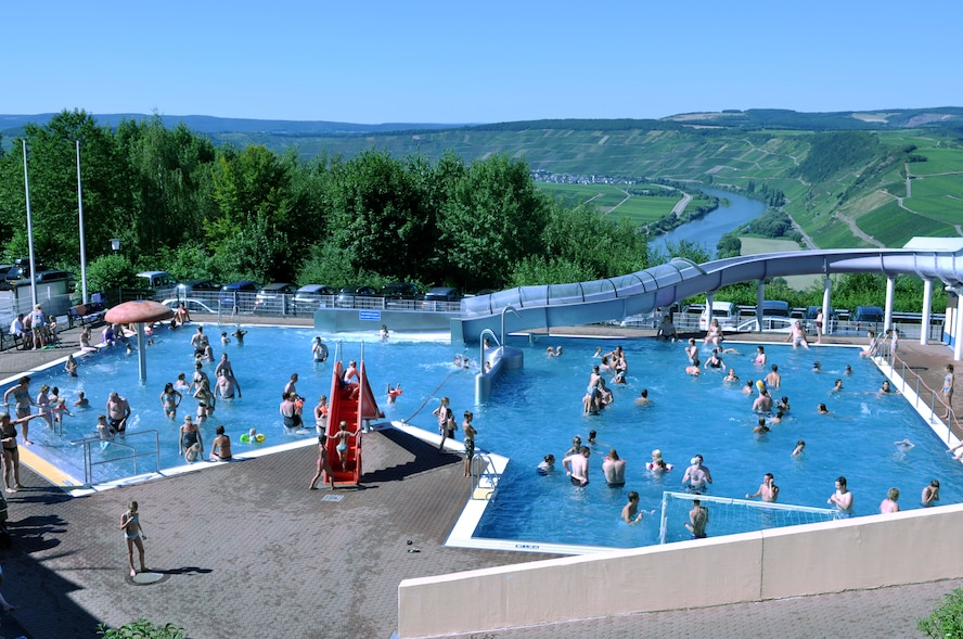 "The ""Roman Wine Street Panorama"" swimming pool in Leiwen is an attraction in the local area because of its' unique panorama location. It can be found on a hill outside the wine town of Leiwen, located on a hill, overseeing the Mosel River.   The pool offers swimmer's and non-swimmer's a toddler's pool, a 76-meter giant slide, a children's wide slide and a water fountain. Like most local outdoor pools, the Leiwen facility is open now through the end of September, depending on weather. The town of Leiwen is located about 20 minutes from base. (U.S. Air Force photo by Iris Reiff/Released)"