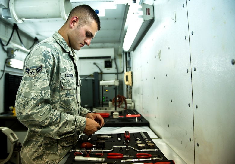 Airman 1st Class Giovanni Costanza, 39th Maintenance Squadron technician, organizes tools for work Aug. 2, 2013, at Incirlik Air Base, Turkey. With the wide array of tools Costanza uses, it can take up to two and a half hours of preparation time prior to performing maintenance. (U.S. Air Force photo by Senior Airman Daniel Phelps/Released)
