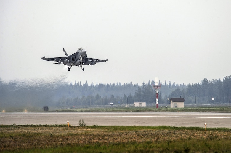 A Navy F/A-18 Hornet from the 113th Fighter Squadron, Naval Air Station Lemoore, Calif., takes off for a familiarization flight Aug. 9, 2013, from Eielson Air Force Base, Alaska. The F/A-18 is a twin-engine supersonic multirole fighter jet designed for air-to-air and air-to-ground combat. (U.S. Air Force photo/Senior Airman Zachary Perras)
