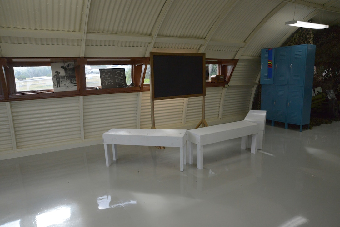 Decades ago, most on-base, indoor activities took place in Quonset huts.  This shows how a hut used for daily briefings would have looked in its hayday.  This is the last standing Quonset hut on Kadena Air Base, Japan.  It was recently renovated to show Airmen of today what life was like on their base years ago. (U.S. Air Force photo by Tech. Sgt. Jocelyn Rich-Pendracki/Released)