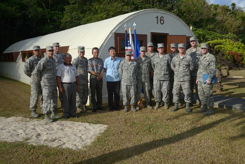 Members of the 18th Civil Engineer Squadron who volunteered their time and skills to renovate the last standing Quonset hut on Kadena Air Base, Japan, stand in front of the newly unveiled piece of Kadena history, along with Col. Charles McDaniel, 18th Wing vice commander, Chief Master Sgt. Ramon Colon-Lopez, 18th Wing command chief, and distinguished guests Sadashi HIga, Kazuto Higa and Jimmy Schwartz, Aug. 12, 2013. (U.S. Air Force photo by Tech. Sgt. Jocelyn Rich-Pendracki/Released)