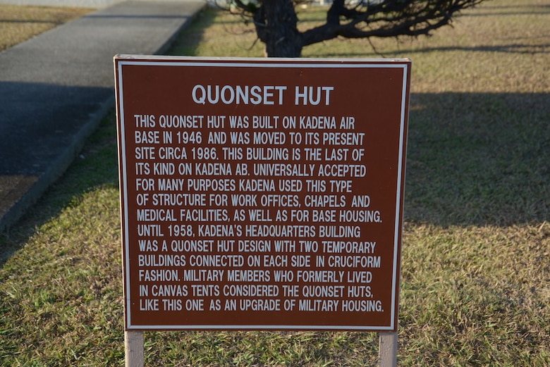 A sign rests outside the only remaining Quonset hut on Kadena Air Base, Japan. This hut was completely restored to give visitors an idea of what life was like during the days of Quonset hut use. (U.S. Air Force photo by Tech. Sgt. Jocelyn Rich-Pendracki/Released)