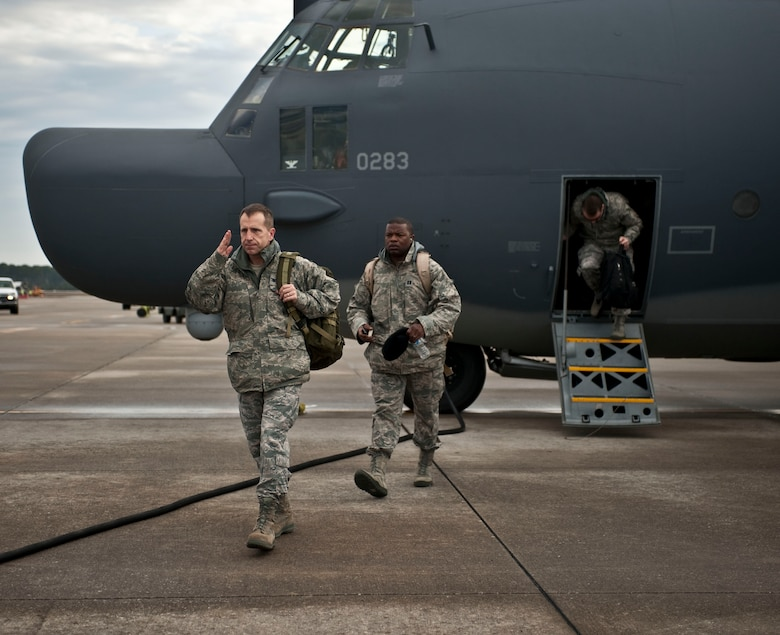 Col. Jim Slife, commander of 1st Special Operations Wing, disembarks from a Combat Talon II on the flightline at Hurlburt Field, Fla., Feb. 21, 2012. Capt. Myron Chivis, commander's executive of 1st SOW, follows the commander to his next location. (U.S. Air Force photo / Airman 1st Class Hayden Hyatt)