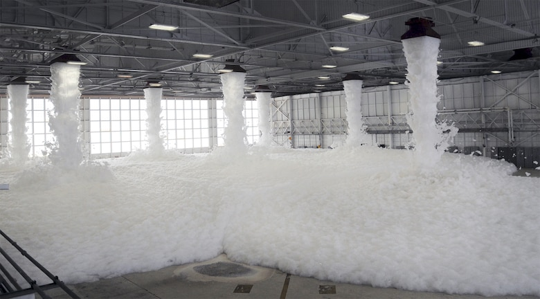 PATRICK AFB, Fla. -- The 920th Rescue Wing Maintenance Group tested one of its fire-suppression systems here today at 1 p.m. in Hangar 750. Pictured here, the system spews high-expansion foam from massive, fan-driven generators in the hangar ceiling. The foam is non-toxic and requires no clean up (it evaporates). According to Patrick AFB Assistant Fire Chief Dallas More, the system is capable of extinguising a fire in less than 30 seconds. (U.S. Air Force photo by Master Sgt. Paul Flipse)