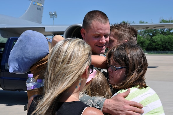 Staff Sgt. Anthony Welden receives huge welcome home hugs and tears from wife and children after returning home from Southwest Asia Tuesday Aug. 6.  Welden and about 13 other members from the 137th Air Refueling Wing, Oklahoma Air National Guard spent nearly 70 days overseas in support of combat operations.  Returning members were not only greeted by loved ones, but also by Gen. Paul J. Selva, commander, Air Mobility Command and Maj. Gen. Myles L. Deering, the adjunct general, Oklahoma National Guard.  After being thanked for their efforts, they were cut loose to go spend well-needed time with family and friends. (U.S. Air Force Photo/Senior Airman Mark Hybers)
