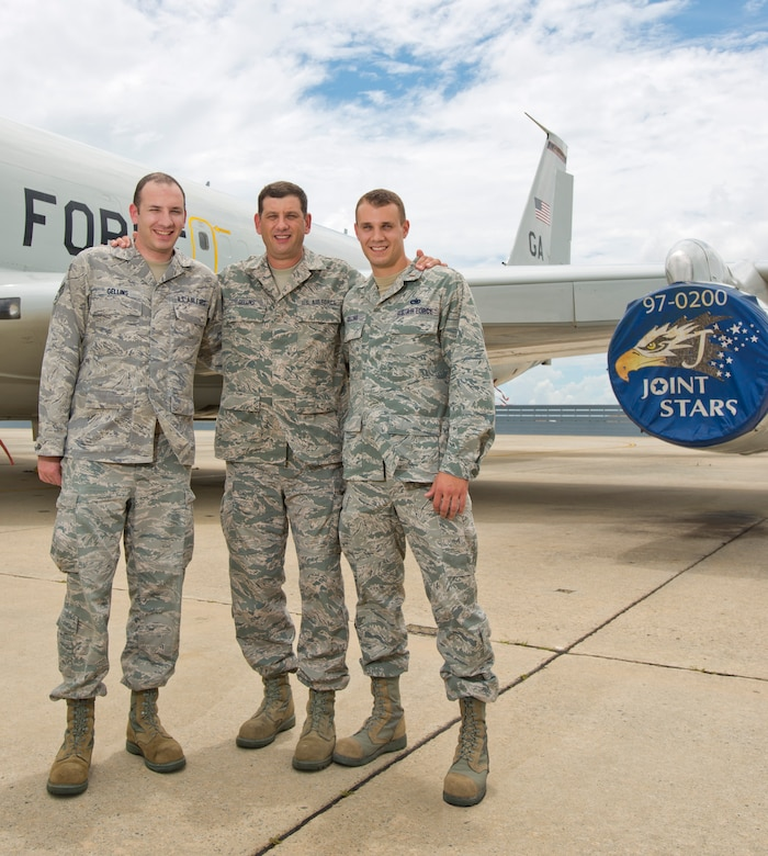 Master Sgt. Kenneth Gellins, center, poses with his sons 2nd Lt. Brett Gellins, right, and Senior Airman Casey Gellins, in front of an E-8C Joint STARS, Robins Air Force Base, Ga., July 14, 2013.  The father and sons, who currently serve together in the 116th Air Control Wing, Georgia Air National Guard, have a long history of family members who have served in the military dating back to the Revolutionary War. (Photo by Master Sgt. Roger Parsons/Released)