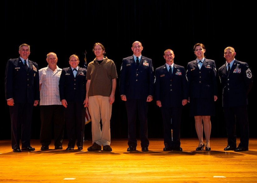 Col. Al Miller, 437th Airlift Wing vice commander (left), and Chief Master Sgt. Shawn Hughes, 437th AW command chief (right), congratulate the 437th Airlift Wing 2nd Quarter Award Winners after a ceremony Aug. 8, 2013, at Joint Base Charleston – Air Base, S.C. (Left to right) Larry Smith, 437th Operations Support Squadron airfield manager, 1st Lt. Andrea Gehrman, 437th Maintenance Group assistant aircraft maintenance unit officer in charge, Gregg Passmore, 437th Aerial Port Squadron material handler, Tech. Sgt. Joshua Denny, 16th Airlift Squadron Soll II evaluator loadmaster, Master Sgt. Seth Malcolm, 16th Airlift Squadron loadmaster and Senior Airman Anna Sozzi, 437th OSS intelligence analyst. The winners were nominated for creating a process which includes better coverage of maintenance support activities, improve quality of life, evenly distribute the workload for all shifts and create more reliable work schedules for maintenance workers. (U.S. Air Force photo/Tech. Sgt. Rasheen Douglas)
