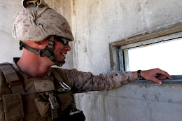 Cpl. Tom Valliant watches M67 Fragmentation Grenades explode through a window in the observation tower of Range 109 here Aug. 13. Twenty-four Marines with Marine Air Support Squadron 3 of 3rd Marine Aircraft Wing here conducted live-fire grenade training here. Valliant is an air support operator with the support squadron here.