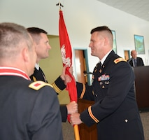 Incoming Mobile District Commander Col. Jon Chytka receives the Corps of Engineers Command Flag from South Atlantic Division Commander Brig. Gen. Donald Jackson during Mobile District's Change of Command Ceremony, which was held Aug. 1, 2013 in downtown Mobile, Ala. at the Alabama Cruise Terminal. The Change of Command tradition dates back to the Civil War and emphasizes the continuity of leadership and unit identity despite changes in individual authority from one another. The heart of the ceremony is the passing of the command flag - the symbol of the unit's identity - from the outgoing commander to incoming commander. Col. Chytka succeeded previous Mobile District Commander Col. Steven Roemhildt. Photo by Lance Davis, Mobile District Public Affairs Office.
