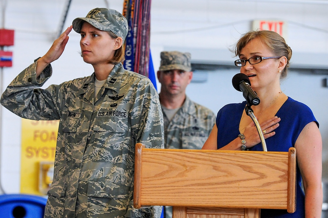 Susan Cotten, commander's secretary of 1st Special Operations Wing, right,