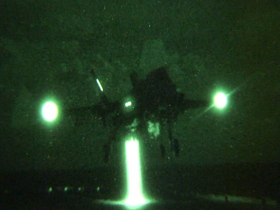 """Lt. Col. C.R. """"Jimi"""" Clift makes the first F-35B Lightning II night landing on USS Wasp  during the second at-sea F-35 developmental test event, Aug. 14. The F-35 Integrated Test Force  is embarked on the Wasp for three weeks to expand the F-35B operational envelope in preparation for Marine Corps initial operational capability test in 2015. (Photo by MCSN Michael T. Forbes II, U.S. Navy)"""