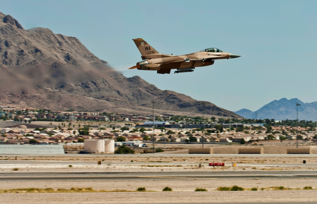 An F-16 Fighting Falcon assigned to the 64th Aggressor Squadron takes off for a training flight Aug. 13, 2013, at Nellis Air Force Base, Nev. Aggressor pilots utilize adversary tactics and act as hostile forces during air-combat exercises. (U.S. Air Force photo/Airman 1st Class Joshua Kleinholz)