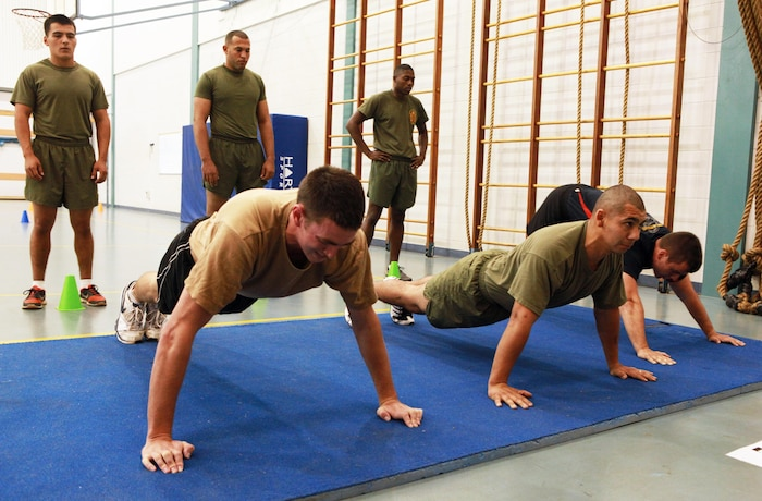 Marines with Marine Rotational Force - Darwin and Australian soldiers conduct a maximum set of pushups in two minutes as part of a Combat Fitness Leadership Course Barrier Test at the Northern Gym, here, July 30. This was one of seven different exercises participants had to complete. The top two Marine performers in the barrier test will attend the month-long CFLC.