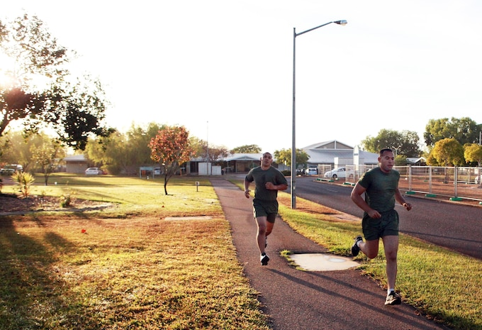 Sgt. Michael Valentino (left) and Cpl. Luis Vasquez (right), both automotive mechanics, Lima Company, 3rd Battalion, 3rd Marine Regiment, Marine Rotational Force - Darwin, complete a 2.4-kilometer run as part of a Combat Fitness Leadership Course Barrier Test, here, July 30. This was one of seven different exercises participants had to complete. The top two Marine performers in the barrier test will attend the month-long CFLC.