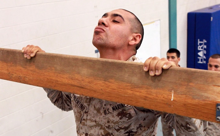 Sgt. Michael Valentino, automotive mechanic, Lima Company, 3rd Battalion, 3rd Marine Regiment, Marine Rotational Force - Darwin, conducts heaves, known in the U.S. as pull-ups, as part of a Combat Fitness Leadership Course Barrier Test at the Northern Gym, here, July 30. This was one of seven different exercises participants had to complete. The top two Marine performers in the barrier test will attend the month-long CFLC.