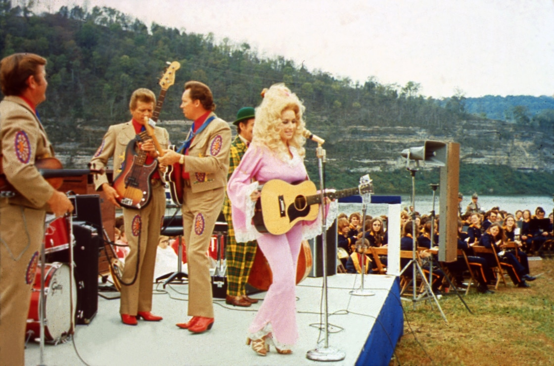 Country Music Star Dolly Parton performs at the Cordell Hull Dam Dedication Oct. 13, 1973 on the shore of the Cumberland River at the dam in Carthage, Tenn. According to an Associated Press report following the event about 2,000 people attended. Tricia Nixon Cox, daughter of President Richard M. Nixon, was the keynote speaker at the dedication.