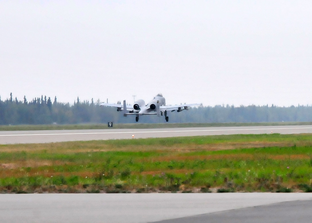 A-10 Thunderbolt aircraft, 122nd Fighter Wing, 163rd Fighter Squadron, Indiana Air National Guard, Ft. Wayne, Ind. taxi and take-off as part of RED FLAG-Alaska 13-3, Aug. 12, 2013, Eielson Air Force Base, Alaska. (U.S. Air Force photo by Staff Sgt. Kirsten Wicker/Released)