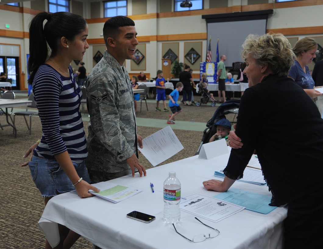 Airman 1st Class Radames Leon Ayala, 341st Security Forces Squadron member, and his wife, Soheyshalie, talk to Ruth Uecker, Great Falls Public Schools assistant superintendent for kindergarten through sixth grade, during the second annual GFPC Information Fair at the Grizzly Bend on Aug. 12. Ayala and his wife attended the fair to register their son in kindergarten. (U.S. Air Force photo/Senior Airman Katrina Heikkinen)
