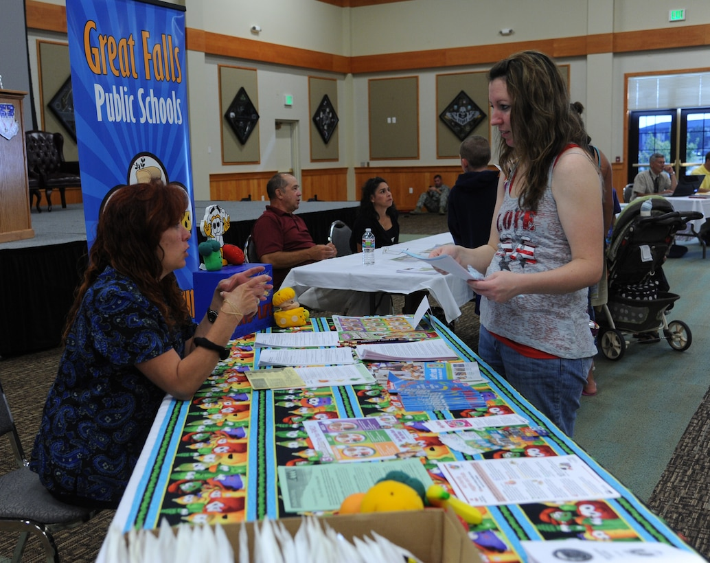 Nichole Travis, spouse of Staff Sgt. Ryan Travis, 341st Civil Engineer Squadron member, right, talks to Stephanie Bautista, Great Falls Public Schools district food supervisor, during the second annual GFPS Information Fair at the Grizzly Bend on Aug. 12. Bautista explained the lunch menu at Loy Elementary School. (U.S. Air Force photo/Senior Airman Katrina Heikkinen)