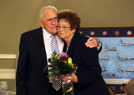 James Norwood, an electronic intelligence advisor with the National Security Agency's representative office at United States Strategic Command, embraces his wife Jean while saying his farewell at his retirement ceremony held at the Patriot Club July 31 on Offutt Air Force Base, Neb.  Jean has been alongside her husband for 59 years of his nearly 60 years of federal service.  (U.S. Air Force photo by Josh Plueger/Released)