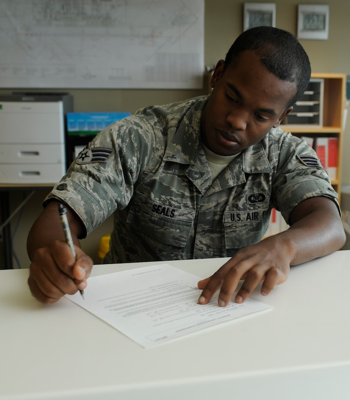 U.S. Air Force Senior Airman James Seals, 366th Operations Support Squadron airfield management shift lead, fills out paperwork, Aug. 13, 2013, at Mountain Home Air Force Base, Idaho. Airfield management personnel are determined to always stay productive despite fluctuating operation tempos. (U.S. Air Force photo by Airman 1st Class Shane M. Phipps/Released)