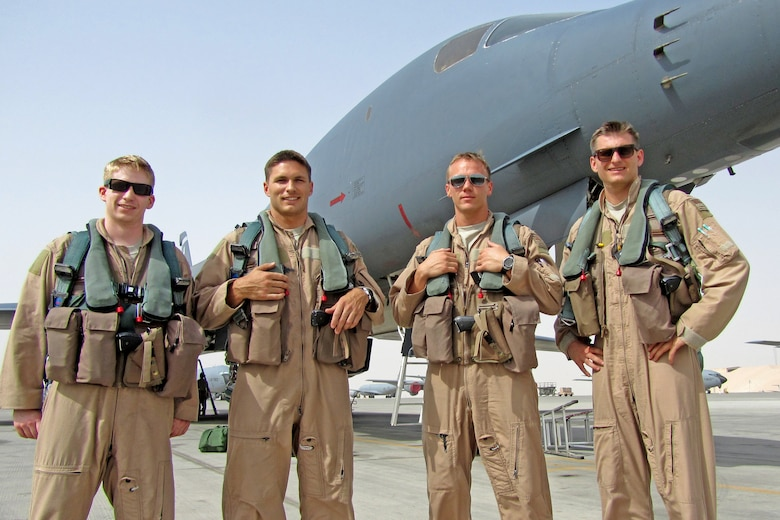 1st Lt. Anthony Rocco, Capt. Jeremy Stover, Capt. Dustin and 1st Lt. Travis Keene pose for a group photo in front of a B-1B Lancer in Afghanistan. The aircrew was named the Air Force's 2012 Bomber Crew of the Year and was awarded with the Air Force Association's Gen. Curtis E. LeMay Award. (Courtesy photo)