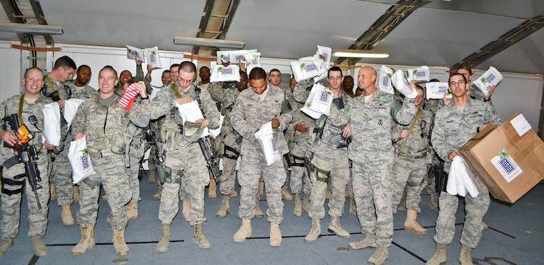 Airmen deployed to the 64th Expeditionary Security Forces Squadron received Christmas-In-July care packages from the United Services Organization, Inc., in Southwest Asia, Aug. 8, 2013. (U.S. Air Force photo/Staff Sgt. Minerva Rosario)