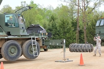 Military Spouses operating heavy equipment.