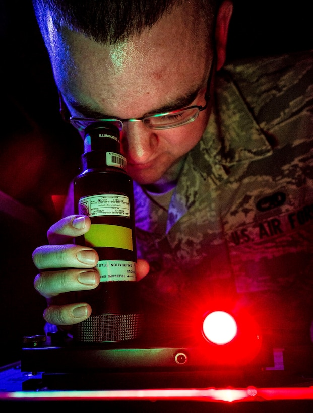 Senior Airman Nicholas Macdonald performs a night-vision goggle inspection Aug. 8, 2013, at Joint Base Charleston, S.C. Airmen from Shaw Air Force Base, S.C., conducted the training here because their night-vision inspection equipment was undergoing maintenance.  Macdonald is a precision measurement equipment laboratory calibration technician assigned to the 20th Component Maintenance Squadron. (U.S. Air Force photo/Senior Airman Dennis Sloan)