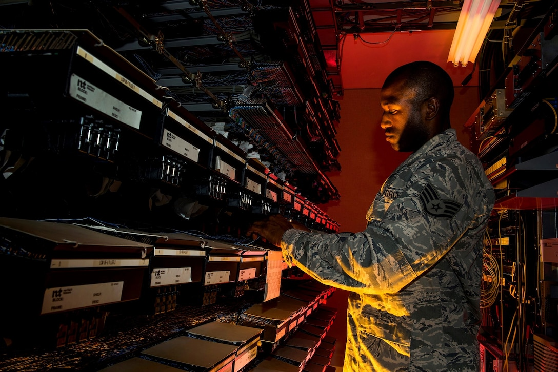 Staff Sgt. Spenser Amos finds a new number location on a line equipment number block Aug. 8, 2013, at Joint Base Charleston, S.C. The infrastructure flight maintains all communications cabling including copper wiring, indoor cabling, outdoor cabling and all telephone switches. Amos is a cyber transport systems technician assigned to the 628th Communications Squadron. (U.S. Air Force photo/Senior Airman George Goslin)