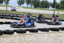 Dads drive and race their children on this day of fun for the Marine Corps Detachment Fort Leonard Wood.