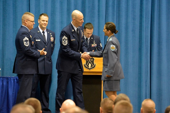 MCGHEE TYSON AIR NATIONAL GUARD BASE, Tenn. - Chief Master Sgt. Ronald C. Anderson, command chief master sergeant, Continental U.S. North American Aerospace Defense Command Region, and 1st Air Force (Air Forces Northern), Tyndall Air Force Base, Fla., congratulates Sergeant Yordanka S. Petrova-Angelova with the Bulgarian air force during a graduation ceremony here for U.S. Air Force Noncommissioned Officer Academy and Airman Leadership School, instructed by the Paul H. Lankford Enlisted PME Center. Petrova-Angelova graduated from NCOA and Bulgarian Corporal Stoyko V. Stoykov graduated from ALS August 15, 2013 as a result of international relations built through the Tennessee National Guard State Partnership Program. (U.S. Air National Guard photo by Master Sgt. Kurt Skoglund/Released)