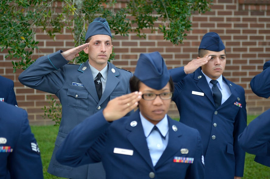 MCGHEE TYSON AIR NATIONAL GUARD BASE, Tenn. - Corporal Stoyko V. Stoykov with the Bulgarian air force salutes with U.S. Air Force members and classmates here August 15, 2013, during a reveille ceremony at the I.G. Brown Training and Education Center. Stoykov graduated from the U.S. Air Force Airman Leadership School, instructed by the Paul H. Lankford Enlisted PME Center, along with Bulgarian Sergeant Yordanka S. Petrova-Angelova, who graduated from the Noncommissioned Officer Academy, as a result of international relations built through the Tennessee National Guard State Partnership Program.  (U.S. Air National Guard photo by Master Sgt. Kurt Skoglund/Released)