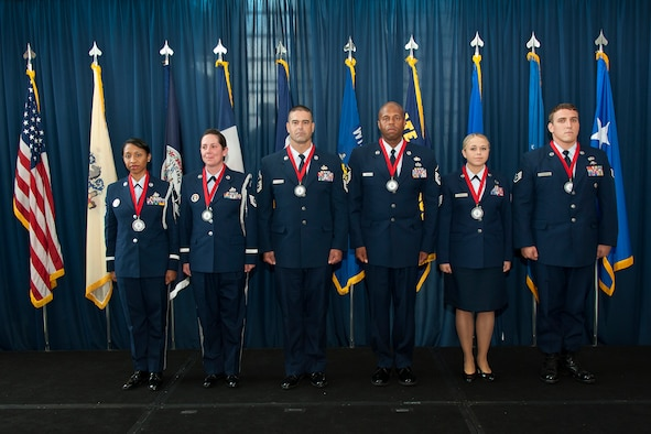 The six Outstanding Air National Guard Airmen of the Year are recognized with awards for excellence during the Director's All-Call event at the ANG Readiness Center, Joint Base Andrews Md. August 14, 2013. (left to right) Master Sgt. Olympia D. Williamson, 136th Airlift Wing, Texas ANG, Technical Sgt. Jamie L. Jones, 108th Refueling Wing, New Jersey ANG, Senior Master Sgt. Mike A. Schmaling, 128th Refueling Wing, Wisconsin ANG, Master Sgt. Andre S. Davis from the 203rd RED HORSE (Rapid Engineer Deployable, Heavy Operational Repair Squadron, Engineer) Virginia ANG, Technical Sgt. Melissa A. Knight, 185th Refueling Wing, Iowa ANG, Staff Sgt. Chadwick Boles from the 125th Special Tactics Squadron, Oregon ANG. (U.S. Air National Guard photo by Master Sgt. Marvin R. Preston/RELEASED)