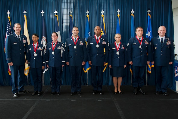 Lt. Gen. Stanley E. Clarke III; the director of the Air National Guard(left) and Chief Master Sergeant James W. Hotaling; Air National GuardCommand Chief (far right); recognize the six Outstanding Airmen of the Year with awards for excellence during the Director's All-Call event at the ANG Readiness Center; Joint Base Andrews Md. August 14; 2013. (left to right)Master Sgt. Olympia D. Williamson; 136th Airlift Wing; Texas ANG; TechnicalSgt. Jamie L. Jones; 108th Refueling Wing; New Jersey ANG; Senior MasterSgt. Mike A. Schmaling; 128th Refueling Wing; Wisconsin ANG; Master Sgt.Andre S. Davis from the 203rd RED HORSE (Rapid Engineer Deployable; Heavy Operational Repair Squadron; Engineer) Virginia ANG; Technical Sgt. MelissaA. Knight; 185th Refueling Wing; Iowa ANG; Staff Sgt. Chadwick Boles fromthe 125th Special Tactics Squadron; Oregon ANG. (U.S. Air National Guardphoto by Master Sgt. Marvin R. Preston/RELEASED)