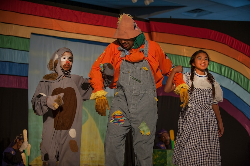 "Toto, played by Caitlin Ashbaugh (left), daughter of Christy Ashbaugh, and Dorothy, played by Alyza Ablang (right), daughter of Master Sgt. Maria Ablang, 628th Aerospace Medicine Squadron, and Tech. Sgt. Paolo Ablang, 628th AMDS, participate in the stage production of ""The Wizard of Oz"" Aug. 2, 2013, produced by the Missoula Children's Theatre and the Youth Programs Center at Joint Base Charleston- Weapons Station, S.C. The Missoula Children's Theatre International Tour has fostered development life skills in more than a million children. This year alone, the Missoula Children Theatre will work with 65,000 children in more than 1,200 communities in all 50 states and 17 countries. (U.S. Air Force photo/Senior Airman Ashlee Galloway)"