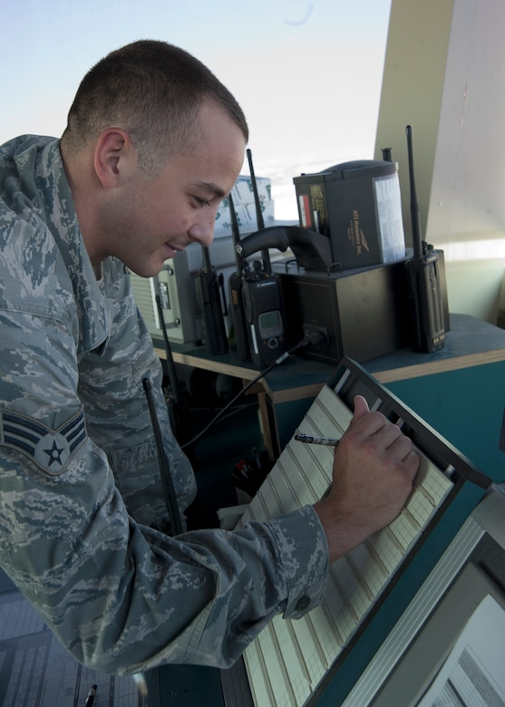 Senior Airman Kevin Krippner fills out a flight progress strip used to keep track of aircraft entering and exiting the airfield at the 379th Air Expeditionary Wing in Southwest Asia, Aug. 13, 2013. Krippner is a 379th Expeditionary Operations Support Squadron air traffic controller deployed from Holloman Air Force Base, N.M., and hails from Winchester, Va. (U.S. Air Force photo/Senior Airman Bahja J. Jones)