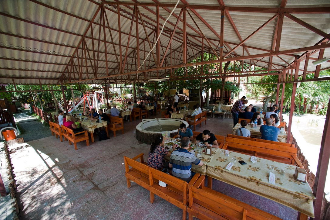 Visitors to Saklibahce sit in one of the picnic areas Aug. 11, 2013, at Pozanti, Turkey. All of the food served at Saklibahce was harvested on location. (U.S. Air Force photo by Senior Airman Daniel Phelps/Released)