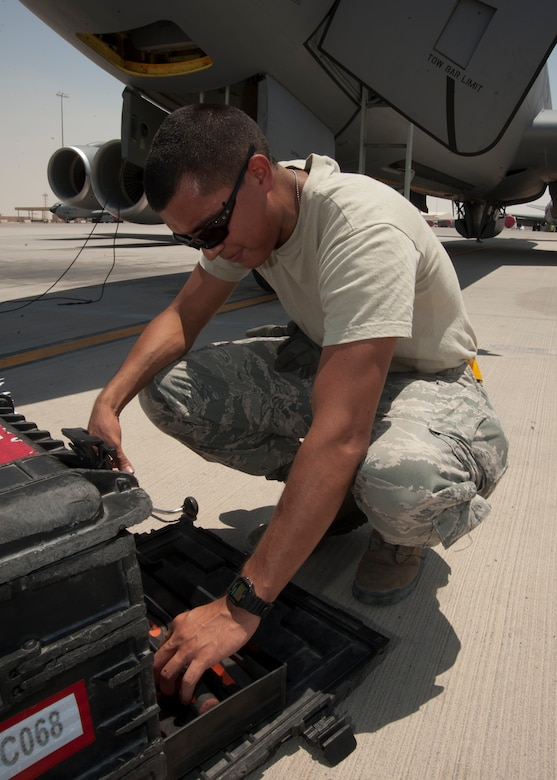 Airman 1st Class Marcus Torres selects a tool from a kit to be used during a KC-135 thru flight inspection at the 379th Air Expeditionary Wing in Southwest Asia, Aug. 13, 2013. Torres is a 340th Expeditionary Aircraft Maintenance Unit crew chief deployed from McConnell Air Force Base, Kan., and a Tucson, Ariz., native. (U.S. Air Force photo/Senior Airman Bahja J. Jones)