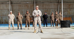 U.S. Marines 1st Lt Ryan Trunk with Law Enforcement Battalion, 3rd Marine Expeditionary Force Headquarters Group, III Marine Expeditionary Force, speaks during the opening ceremony of Non-Lethal Weapons Executive Seminar (Knoles) in Five Hills Training Area, Mongolia, August 17, 2013. Knoles is a regularly scheduled field training exercise and leadership seminar sponsored annually by U.S. Marine Corp Forces Pacific, and it is designed to promote awareness and effective use of non-lethal weapons as a tool to maintain order in low-intensity or civil unrest situations.(U.S. Marine Corps Photo by Sgt John M. Ewald/released)