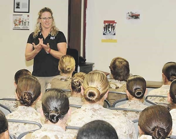 Coach Andrea Hudy, University of Kansas assistant athletic director for sport performance, talks with female Marines about leadership during a visit last week.