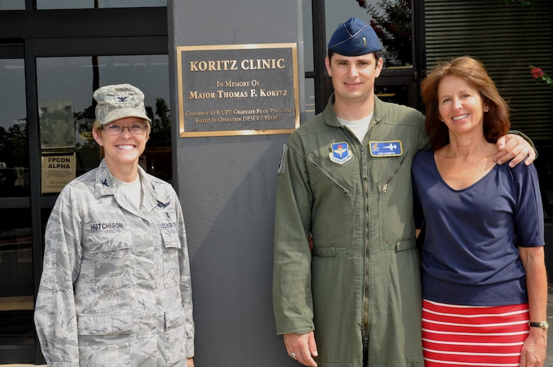 Col. Billye Hutchison (left) poses for a photo with 2nd Lt. Jon Koritz, Specialized Undergraduate Pilot Training Class 13-13 graduate, and his mother Julianne Koritz Aug. 3, 2013, outside of the Koritz Clinic at Seymore Johnson Air Force Base, N.C. The Koritz Clinic was renamed in 2008 in honor of Maj. Thomas Koritz after he was killed in action during the second night of combat in Operation Desert Storm in 1991. Hutchinson is the 14th Medical Group commander.